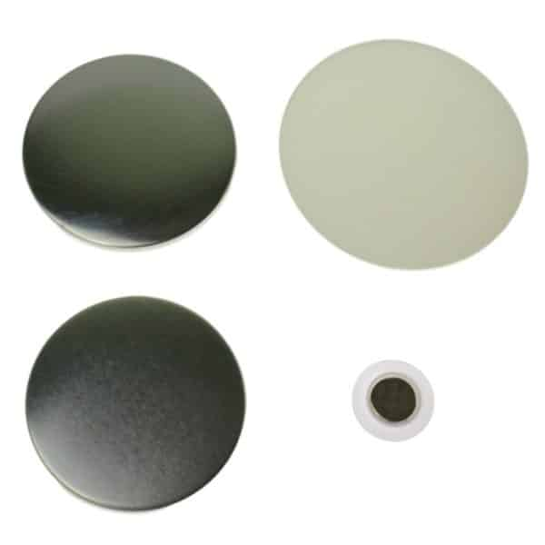 Component parts to make a 58mm clothing magnet comprising of metal disc front, metal disc flat back, clear plastic film covering and white plastic disc with magnet inset