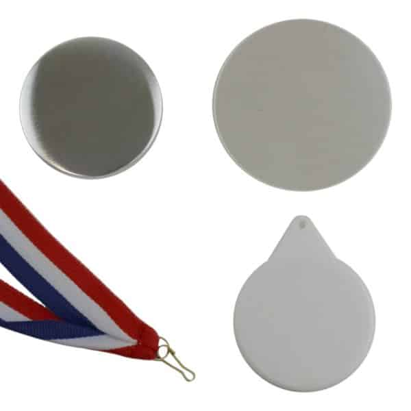 Component parts to make up a 58mm medal with a badge maker including metal fronts, keyring back, clear plastic film and red white and blue ribbon with attachment