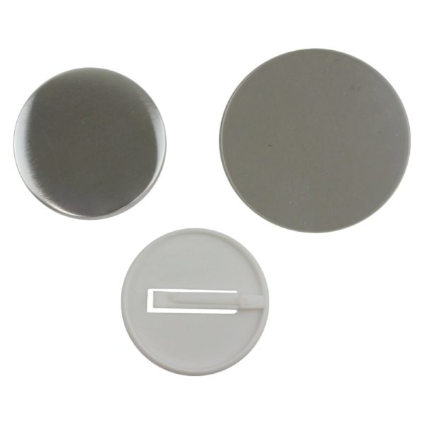 Components for a 58mm supersafe pinless badge to be made in a badge making machine comprising metal front, white plastic clip back and clear plastic film circle