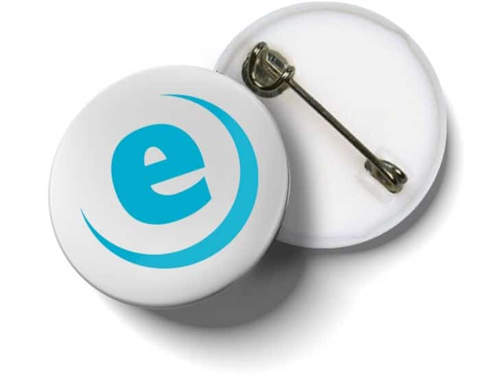 Front and back of a made up circular pin badge